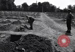Image of Secretary of State Cordell Hull visits U.S. 4th Division Cemetery Normandy France, 1944, second 10 stock footage video 65675027617