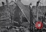 Image of U.S. Marines in improvised shelters  Saipan Northern Mariana Islands, 1944, second 5 stock footage video 65675027622
