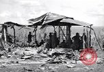 Image of U.S. Marines in improvised shelters  Saipan Northern Mariana Islands, 1944, second 10 stock footage video 65675027622