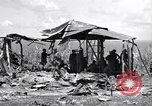 Image of U.S. Marines in improvised shelters  Saipan Northern Mariana Islands, 1944, second 11 stock footage video 65675027622