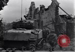 Image of American tanks on streets of St Lo Saint Lo France, 1944, second 10 stock footage video 65675027626
