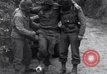 Image of medics assist wounded US Army soldier of 29th Division Saint Lo France, 1944, second 4 stock footage video 65675027648