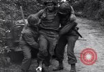 Image of medics assist wounded US Army soldier of 29th Division Saint Lo France, 1944, second 5 stock footage video 65675027648
