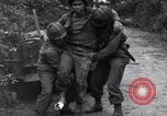 Image of medics assist wounded US Army soldier of 29th Division Saint Lo France, 1944, second 6 stock footage video 65675027648