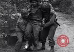 Image of medics assist wounded US Army soldier of 29th Division Saint Lo France, 1944, second 7 stock footage video 65675027648