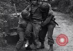 Image of medics assist wounded US Army soldier of 29th Division Saint Lo France, 1944, second 8 stock footage video 65675027648
