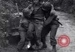 Image of medics assist wounded US Army soldier of 29th Division Saint Lo France, 1944, second 9 stock footage video 65675027648