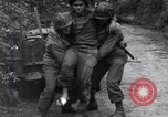 Image of medics assist wounded US Army soldier of 29th Division Saint Lo France, 1944, second 10 stock footage video 65675027648