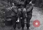 Image of medics assist wounded US Army soldier of 29th Division Saint Lo France, 1944, second 11 stock footage video 65675027648