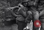 Image of medics assist wounded US Army soldier of 29th Division Saint Lo France, 1944, second 12 stock footage video 65675027648