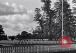 Image of US Army memorial day service at American cemetery Sainte Mere Eglise France, 1945, second 6 stock footage video 65675027651
