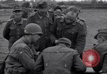 Image of German prisoners questioned by American soldiers Saint Honorine Des Pertes France, 1944, second 4 stock footage video 65675027666