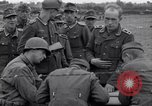 Image of German prisoners questioned by American soldiers Saint Honorine Des Pertes France, 1944, second 10 stock footage video 65675027666