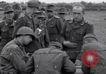Image of German prisoners questioned by American soldiers Saint Honorine Des Pertes France, 1944, second 11 stock footage video 65675027666