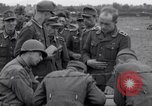 Image of German prisoners questioned by American soldiers Saint Honorine Des Pertes France, 1944, second 12 stock footage video 65675027666