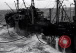 Image of fueling of ship Pacific Ocean, 1945, second 5 stock footage video 65675027917