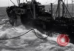 Image of fueling of ship Pacific Ocean, 1945, second 8 stock footage video 65675027917