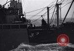 Image of extension of fueling lines Atlantic Ocean, 1945, second 8 stock footage video 65675027918