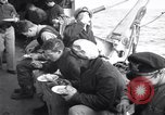 Image of Crew of USCGC Campbell have lunch on deck Nova Scotia, 1943, second 2 stock footage video 65675027942