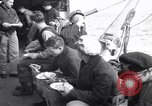 Image of Crew of USCGC Campbell have lunch on deck Nova Scotia, 1943, second 3 stock footage video 65675027942
