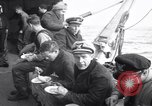 Image of Crew of USCGC Campbell have lunch on deck Nova Scotia, 1943, second 6 stock footage video 65675027942