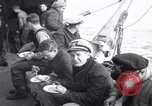Image of Crew of USCGC Campbell have lunch on deck Nova Scotia, 1943, second 7 stock footage video 65675027942