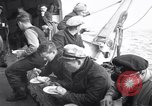 Image of Crew of USCGC Campbell have lunch on deck Nova Scotia, 1943, second 8 stock footage video 65675027942