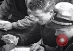 Image of Crew of USCGC Campbell have lunch on deck Nova Scotia, 1943, second 9 stock footage video 65675027942