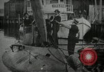 Image of Plunger Class submarine firing a torpedo New Suffolk New York USA, 1904, second 2 stock footage video 65675027950