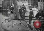 Image of Plunger Class submarine firing a torpedo New Suffolk New York USA, 1904, second 3 stock footage video 65675027950