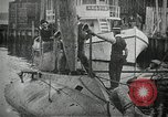 Image of Plunger Class submarine firing a torpedo New Suffolk New York USA, 1904, second 4 stock footage video 65675027950