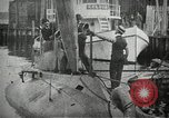 Image of Plunger Class submarine firing a torpedo New Suffolk New York USA, 1904, second 5 stock footage video 65675027950