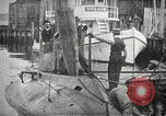 Image of Plunger Class submarine firing a torpedo New Suffolk New York USA, 1904, second 10 stock footage video 65675027950