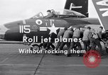 Image of Handling of jet aircraft on carrier flight deck United States USA, 1951, second 12 stock footage video 65675028028