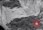 Image of wrecked tanks Marshall Islands, 1944, second 5 stock footage video 65675028033