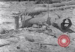 Image of wreckage on beachhead Majuro Marshall Islands, 1944, second 2 stock footage video 65675028038