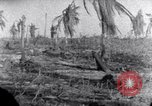 Image of wreckage on Island Marshall Islands, 1944, second 5 stock footage video 65675028039