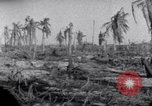 Image of wreckage on Island Marshall Islands, 1944, second 7 stock footage video 65675028039