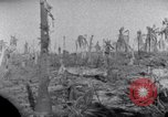 Image of wreckage on Island Marshall Islands, 1944, second 12 stock footage video 65675028039