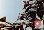 Image of Marines on beachhead Saipan Northern Mariana Islands, 1944, second 12 stock footage video 65675028041
