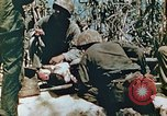 Image of Marines treat wounded Saipan Northern Mariana Islands, 1944, second 8 stock footage video 65675028042