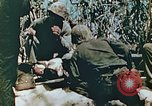 Image of Marines treat wounded Saipan Northern Mariana Islands, 1944, second 10 stock footage video 65675028042