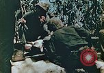 Image of Marines treat wounded Saipan Northern Mariana Islands, 1944, second 11 stock footage video 65675028042