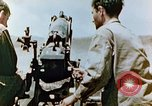 Image of U.S. marines firing artillery Saipan Northern Mariana Islands, 1944, second 7 stock footage video 65675028045