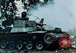 Image of Burning Japanese Type 95 light tank Saipan Northern Mariana Islands, 1944, second 3 stock footage video 65675028046
