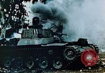 Image of Burning Japanese Type 95 light tank Saipan Northern Mariana Islands, 1944, second 6 stock footage video 65675028046