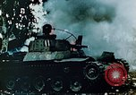 Image of Burning Japanese Type 95 light tank Saipan Northern Mariana Islands, 1944, second 7 stock footage video 65675028046