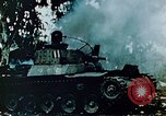 Image of Burning Japanese Type 95 light tank Saipan Northern Mariana Islands, 1944, second 9 stock footage video 65675028046
