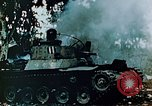 Image of Burning Japanese Type 95 light tank Saipan Northern Mariana Islands, 1944, second 10 stock footage video 65675028046