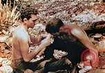 Image of Marine renders first aid to wounded buddy Saipan Northern Mariana Islands, 1944, second 2 stock footage video 65675028048